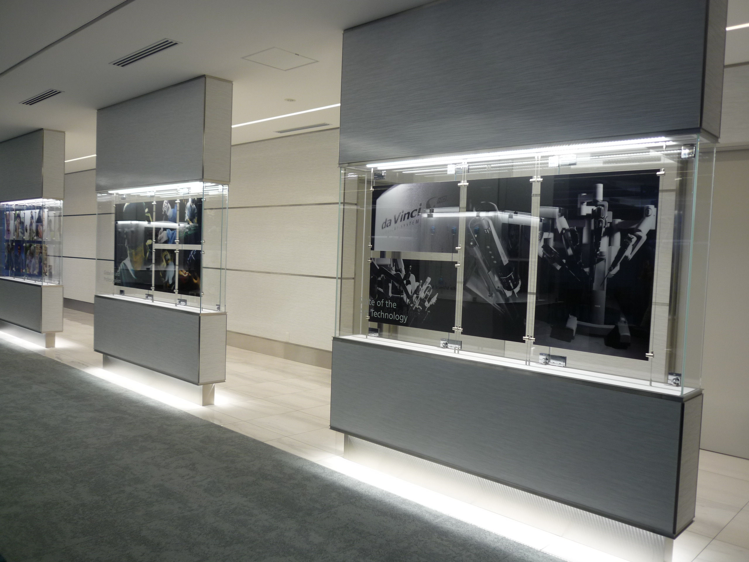double sided light boxes used to display product and patient photos line the hallways celebrating the companys dominance in the market intuitive company office photo